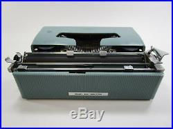 Vintage Olivetti Lettera 32 typewriter blue green retro mid century